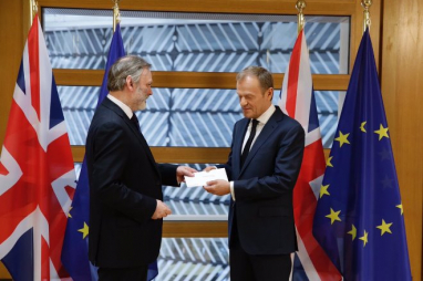 UK ambassador to the EU Sir Tim Barrow hands over the letter triggering Article 50.