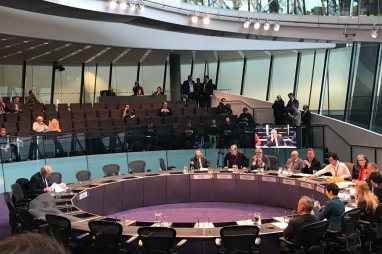 Boris Johnson (left) appearing before the GLA's oversight committee to answer questions about the failed Garden Bridge project.