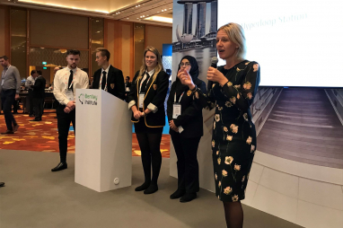 Winning students from Drummond Community High School, Edinburgh, with Class of Your Own chief executive Alison Watson at the Bentley YII conference in Singapore.