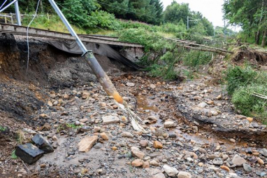 Network Rail are working around-the-clock to repair extensive flood damage on the Edinburgh-Glasgow line, which could see the line out of action for two months.