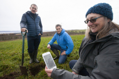 Heathrow director of sustainability Matt Gorman (left), Agricarbon co-founder Stewart Arbuckle, and Helaina Black, senior soil scientist & honorary associate of the James Hutton Institute, at a Dundee carbon farming project supported by Heathrow.