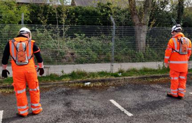 Interserve workers using the SiteZone safety prototypes that help enforce the two-metre rule of social distancing.