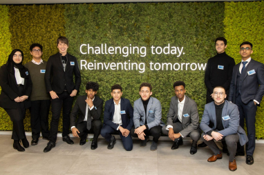 Professor Brian Cox (third from left) with London students at the Jacobs London office opening.