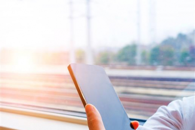 National Infrastructure Commission says passengers will continue to experience inadequate mobile services on the UK's railways due to slow government progress in fixing gaps in connectivity.