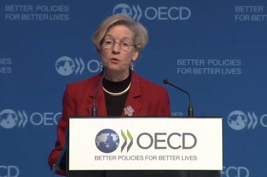 OECD chief economist Catherine Mann delivering the organisation's interim economic outlook.