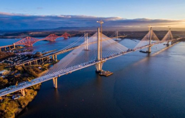 The new Queensferry Crossing with the old Forth Road Bridge and the Forth Rail Bridge in the background.