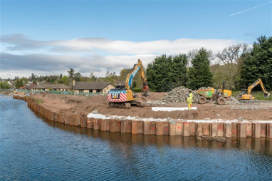 A Balfour Beatty flood protection project underway at Almondbury, West Yorkshire, as Scape Group calls for an urgent 45% funding increase for flood defences in England.
