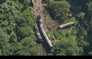 "Rail chief ""acutely aware we need a long-term resolution"" to protect against climate change following fatal derailment."