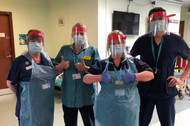 NHS staff in Essex wearing face masks produced on 3D printers by WSP.