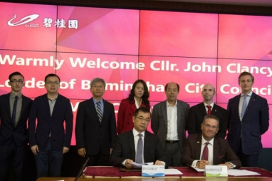 Birmingham Council leader John Clancy (front right) signs an agreement with Country Garden chairman Yang Guoqiang.