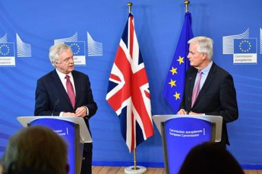 Lead UK negotiator David Davis pictured in Brussels with his EU counterpart, Michel Barnier.