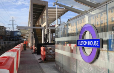 Crossrail's Elizabeth line roundel installed at Custom House station platform.
