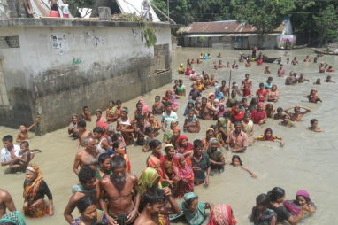 A village in Bangladeshi affected by flooding as a result of global warming.