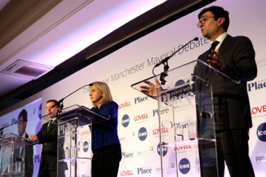 The three candidates - Sean Anstee (Conservative), Jane Brophy (Liberal Democrat) and Andy Burnham MP (Labour) on stage in Manchester.