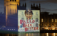 Campaigners project their levelling up message onto parliament.