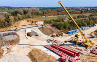 A huge civil engineering project to build two new routes underneath Chiltern main line at Bicester was completed over Easter weekend.