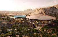 Oman Botanic Garden visitors' centre pavilions and cable car structure.