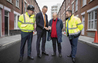 Michael McLoughlin, contracts director at Riney, Roger Eke, technical product support manager at Tarmac, John Biggs, mayor of Tower Hamlets, and Stephen Warway, highways engineer at Tower Hamlets council, inspect the new rubber road at Canrobert Street in Bethnal Green.