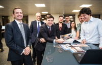 Greater Manchester mayor Andy Burnham with WSP staff looking over the homeless shelter prototype designs during the firm's new office opening in Manchester.