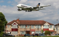 Heathrow Airport says it will reduce night flights and curb noise and pollution if it gets a third runway.